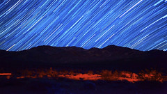 dlapse2still2 (Sunchaser Pictures) Tags: california sky panorama house beauty wheel night stars wonder spiral evening nationalpark timelapse cabin glow technology desert earth space spin alien dream joshuatree trails atmosphere science ufo aliens nasa galaxy lasers future planet laser astronomy hd universe exploration lasershow climate spacecraft polaris milkyway 1080 astronomer spaceflight spaceexploration spiraling deathvalleystartrails