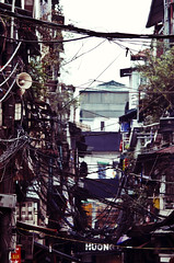 Power Lines (BB Ramone) Tags: city travel nikon asia vietnam powerlines electricity hanoi healthandsafety nikond7000 savethebaby gadventures mynameispong