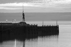 ILFRACOMBE VERITY (davidedmond57) Tags: sea blackandwhite cloud monochrome wall coast harbour north damien statues quay shore ilfracombe hirst verity