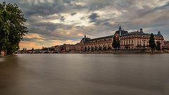 Muse d'Orsay with the Seine still overflowing (Michel Hincker) Tags: outdoor waterfront seine water architecture bridge museum long exposure canon 80d orsay sunset