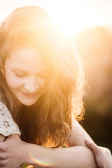 Sun (nicksparksphotography) Tags: sunset portrait woman brown sun white smiling female vintage hair lens model colorado soft looking dress hill 85mm down denver flare dreamy lookingdown ruby fd sunflare brownhair whitedress vintagelens fdlens rubyhill