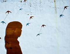 Shadow poetry (campra) Tags: shadow sculpture brown girl birds silhouette metal wall spain paint outdoor espana cordoba sheet peel corrugated