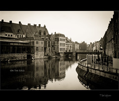 On The Edge (Taropon) Tags: bridge shadow sky reflection building water 50mm canal belgium streetview d3s