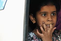 Curious Indian child (Daniele Romeo) Tags: travel people woman india face children women child faces market maharashtra nationalgeographic flickraward danieleromeo flickrtravelaward