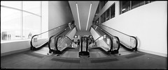 Convergence (heritagefutures) Tags: camera light panorama shopping kodak centre australia shoko widelux civic canberra escalators complex act communications bw400cn panon travelators f6b