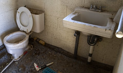Bathroom (Curtis Gregory Perry) Tags: california old loo house ice wall john bathroom bottle garbage sink box decay cement toilet toilette can brush dirty wc cups cube tray block forsaken decrepit dixie banheiro crapper toalett   olancha