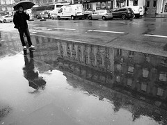 Another world (vieweronline) Tags: street blackandwhite bw paris france monochrome rain contrast noiretblanc streetphotography pluie nb portfolio candids rue gens candidshots photosderue ahmedmokhtar stphotographia canong12 vieweronline