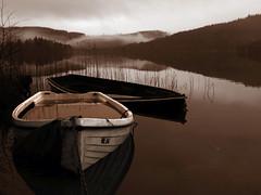 STRONG COFFEE MORNING (explore) (kenny barker) Tags: winter mist reflection water sepia landscape boats lumix scotland explore trossachs landscapeuk panasoniclumixgf1 welcomeuk kennybarker