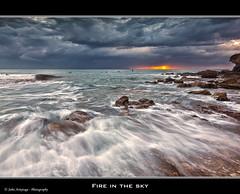 Fire in The Sky (John_Armytage) Tags: seascape beach clouds sunrise canon movement rocks australia nsw northernbeaches warriewood canon1635lf28 warriewoodbeach canon5dmark11