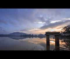 A lovely Day Begins (Jchetan) Tags: road blue sun india mist lake water clouds sunrise imac hues roadside karnataka 1022mm southindia kanakapura canon450d chetanj applealovelydaybegins