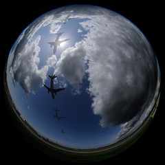 Final Approach (Steve Goodyear) Tags: clouds plane airplane fisheye multipleexposure landing runway flyover flyby d300s