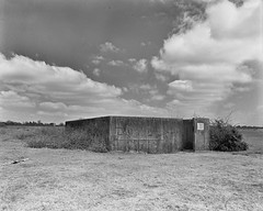 Greenham Common Negative Scan Electrical Building (Rebecca Sharplin Hughes) Tags: white black abandoned mamiya film field army infrared medium format common derelict newbury nato airfield rb67 greenham film:iso=400 developer:brand=agfa film:brand=rollei agfar09oneshot developer:name=agfar09oneshot rolleiinfraredir film:name=rolleiinfraredir400 filmdev:recipe=8414