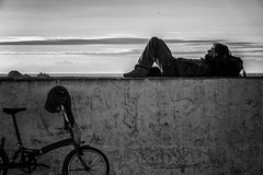 enjoying the sunset (krllx) Tags: africa street light sunset people blackandwhite bw monochrome bike wall lights sundown streetphotography morocco streetphoto bluehour sh essaouira marokko solnedgang mainsquare nikc menneske dsc02438edit201603051