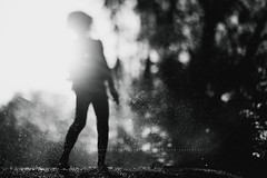 Simply childhood..... (privizzinis passion photography) Tags: lighting light summer people blackandwhite sun motion water monochrome sunshine childhood children fun outdoors movement child play emotion outdoor outoffocus sunflare srpinkler freelensed