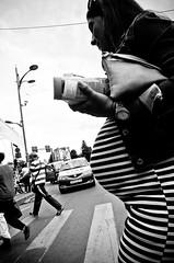 Pregnant (stimpsonjake) Tags: city blackandwhite bw woman monochrome lines candid stripes streetphotography pregnant belly romania crosswalk bucharest crossingthestreet 185mm nikoncoolpixa