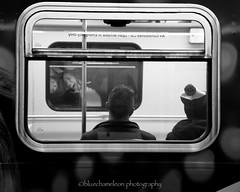 strangers on a train (bluechameleon) Tags: bw woman men window vancouver train underground blackwhite strangers bluechameleon artlibre sharonwish bluechameleonphotography