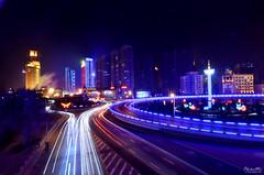 Harbin - Nightly Traffic (Andy Brandl - www.PhotonMix.com) Tags: china longexposure bridge urban cold ice heilongjiang architecture night speed nikon asia cityscape traff
