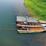 Boats for hire on the river Kwae, Kanchanaburi, Thailand thumbnail