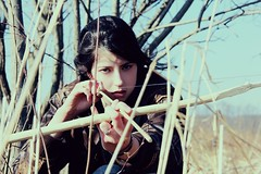 girl on fire (THE PULP GIRLS) Tags: trees nature girl intense bow arrow thehungergames