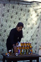 Remains of the Day (Sai Abishek) Tags: street nepal portrait woman beer festival documentary games cans