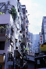 Sheung Wan  (Joybot) Tags: china street 2001 city urban hk building tower film home up shop 35mm island hongkong 50mm asia stair apartment hill steps slide step staircase transparency highrise western streetphoto asie tall   uphill fujica ascend  sheungwan     stx1n