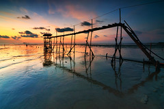 l o w   .    t i d e (sirman88) Tags: longexposure sunset seascape motion outdoors photography pier interestingness nikon dusk geometry jetty malaysia lowtide pantai 2012 calmness revisited ndfilter traveldestinations colorimage nd8 d7000 tokina1116 pantaijeram azmanrahman sirman88