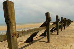 No defence against the sea. (Clear Lady) Tags: sea beach walking wooden sand norfolk pebbles breakwater disintegrating norfolkcoastalpath
