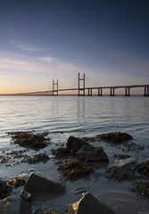 W a t e r s   E d g e (ƇĦŘĺς ΛΨŁЩΛŘĐ ƤĦŎŦŎƓƦΛƤĦϔ) Tags: bridge winter england beauty sunshine wales architecture sunrise river bristol early colours crossing motorway south estuary severn gateway waters welsh m4 vast spanning sudbrook redwick hdcymru