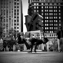 Breakin At Love Park (Joel Levin Photography) Tags: street blackandwhite bw philadelphia square dancing candid streetphotography squareformat lovepark philly breakdancing allrightsreserved breakin iphone mobilephotography flickraward bwartaward thedefiningtouch iphoneography deftouch editedanduploadedoniphone flickrawardgallery joellevin definingtouchgroup