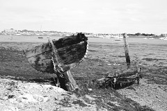 (nic lawrance) Tags: wood old light sea england blackandwhite texture beach water rotting contrast dark boat harbour shipwreck land portsmouth manmade shape