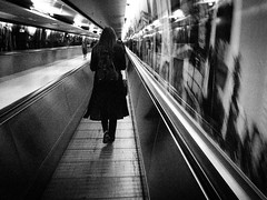 Tunnel Rush (Streets of Nuremberg) Tags: blackandwhite bw monochrome juni blackwhite airport reisen streetphotography tunnel walkway rush flughafen traveler 2016 eile streetfotografie ricohgrii streetsofnuremberg stonurontheroad