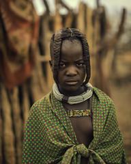 Young Himba Girl (Baron Reznik) Tags: africa portrait girl look vertical hair kid child african traditional tribal afrika tribe ochre ethnic namibia everydaylife braid kaokoveld  afrique plait  kaokoland colorimage  kunene  indigenouspeoples    ovahimba canon50mmf12l  himbapeople omuhimba    republicofnamibia otjize