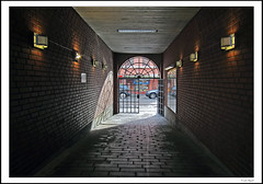 The gate (frode skjold) Tags: oslo norway wall port norge gate cobblestone trondheimsveien schous vegg grunerlkka brostein photoshopelements8 canonpowershots95