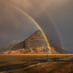 The Rainbows (Kiddi Kristjans) Tags: winter mountain snow reflection water field grass rain misty zeiss fence iceland rainbow double rainbows polarizer sland 105mm suurnes leefilters distagont235 canoneos5dmarkii holtsnpur holtsnupur distagon352ze