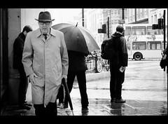 tinker tailor..... (jonron239) Tags: man london hat umbrella tie suit raincoat oxfordcircus clocked thecircus johnlecarr tinkertailorsoldierspy georgesmiley siralecguinness geezerwednesday actuallyitscambridgecircusinthebook whichisaboutamileawayoncharingcrossroad