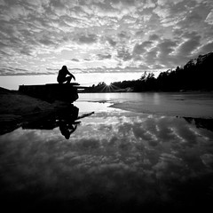 From Dusk Til Dawn.. (Peter Levi) Tags: sea blackandwhite bw man reflection blancoynegro ice water clouds sweden stockholm saltsjbaden blackwhitephotos bestcapturesaoi elitegalleryaoi march2012 dblringexcellence tplringexcellence asquaresuperstarstemple