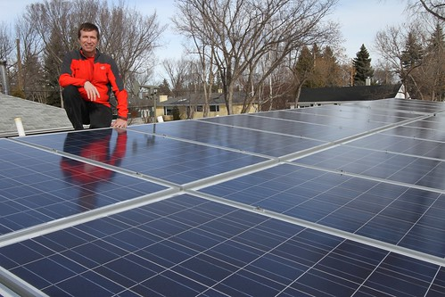 Karl Kovacs on the roof with his 24-panel solar electric system that will produce almost as much electricity as he consumes. - 1