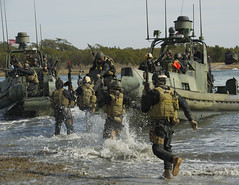 Sailors board a riverine assault boat after executing a hot extract drill. (Official U.S. Navy Imagery) Tags: nc unitedstates necc camplejeune rivron expeditionarycombatcamera boldalligator12 wwwfacebookcomusnavy