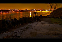 Looking Across to New York City (SunnyDazzled) Tags: nyc newyorkcity longexposure winter newyork history night reflections river gold lights newjersey cityscape view manhattan parkway hudson rockefeller viewer yonkers georgewashingtonbridge palisades viewfinder wayside paytelescope