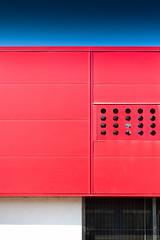 172 - Grill (StormPictures) Tags: blue windows red white black glass lines architecture canon circle rouge eos noir colours steel perspective moderne bleu 5d grille blanc btiment 1740 lignes fer vitres urbain simmetry acier bton ronds perspectiv contemporain gymnase tle symmtrie