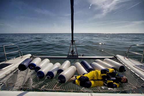 sleeping sea net water boat sailing yacht sleep gib north trampoline genoa catamaran sail rest resting sailor athena gill fontaine fenders 38 powerranger oilskin pajot