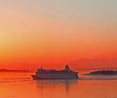 To Helsinki at sunrise (nahkahousu) Tags: morning red sea sky orange water sunrise helsinki ship group balticsea tallin icapture eckerline flickraward nahkahousu thisphotorocks flickrestrellas vanagram oltusfotos 100comment mygearandme flickrtravelaward rememberthatmoment