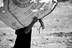 Weight on Your Shoulders (Alex E. Proimos) Tags: world poverty people bw white black work bag destruction transport poor hard environmental dump growth tip basura rubbish damage labour environment worker shoulders waste weight infinite struggle landfill sustainability fill strain destroy develop developing transporting sustain cero reciclable botadero