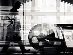 Never look back (Captivating World) Tags: blackandwhite man reflection glass person construction europe belgium object escalator places antwerp technique centralstation