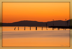 A Gift of Amber and Gold (Morrow Cove) Tags: california usa reflection water night dark landscape gold golden evening amber dock photographer unitedstates dusk vallejo strait msm saltmarsh confluence twighlight mareisland carquinez crystalpointe