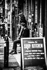 Welcome to Soup kitchen (tootdood) Tags: people blackandwhite kitchen manchester soup sitting sit welcome sat seated streetcandid stevensonsquare canon70d