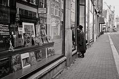 Window shopping (Mr.White@66) Tags: urban holland netherlands amsterdam streetphotography blackwhitepassionaward