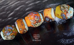 Rocks Melons and Shadows (Laura Blanck Openstudio) Tags: show pink blue red etched orange usa abstract green art glass yellow coral festival set one beads big sand rocks colorful warm published artist glow handmade stones fine arts almond funky jewelry pebbles frog kind made odd earthy burnt mango winner copper tropical huge opaque mustard organic kiln nuggets murano umber maize lampwork multicolor raku artisan suede matte whimsical loose openstudio asymmetric ocher speckles annealed opestudiobeads
