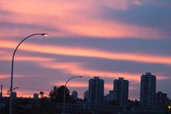 Urban Sunset (hilarymcurrie) Tags: new city sunset urban sun canada west colors westminster skyline vancouver buildings fire lights evening coast twilight colours bc skyscrapers sundown dusk towers columbia burnaby british condos decor cloudscape