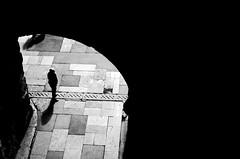 Human in geometry (Claudio Taras) Tags: street shadow people bw nikon bokeh claudio biancoenero controluce trier portanigra taras streetshot contrasto